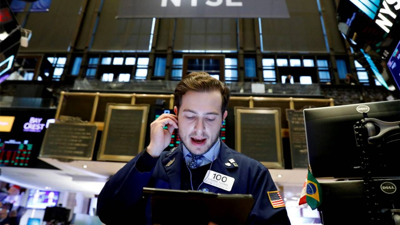 A Wall Street Trader on the trading floor. Next Avenue, index funds, ETFs, S&P 500