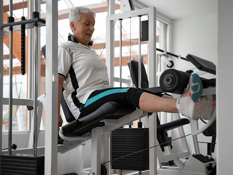 A woman doing a knee extension exercise. Next Avenue, exercise, dementia, alzheimer's