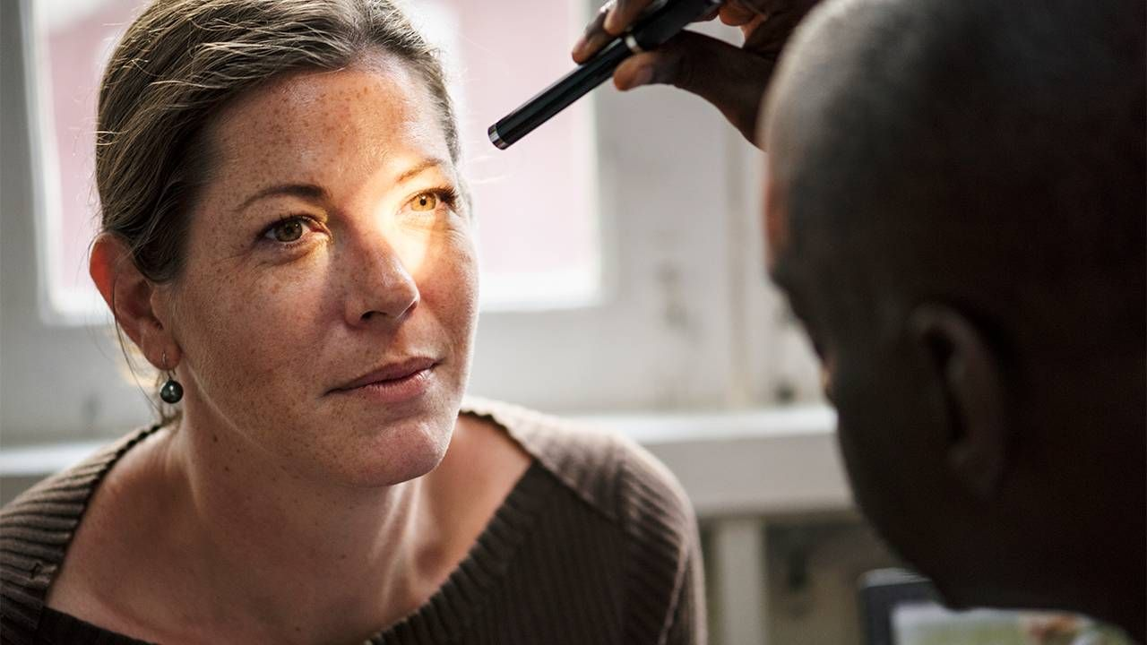 A woman at an eye doctor appointment. Next Avenue, floaters in eye, vitreous
