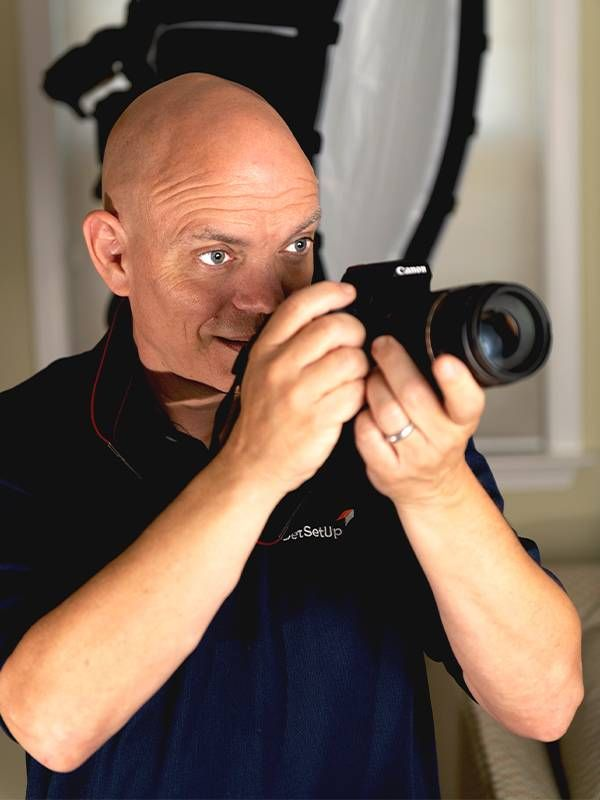 A man holding a camera. Next Avenue, adult education, peer learning
