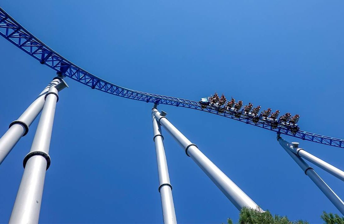 A roller coaster reaching the highest point in the ride. Next Avenue, phobias, overcoming, fear of heights
