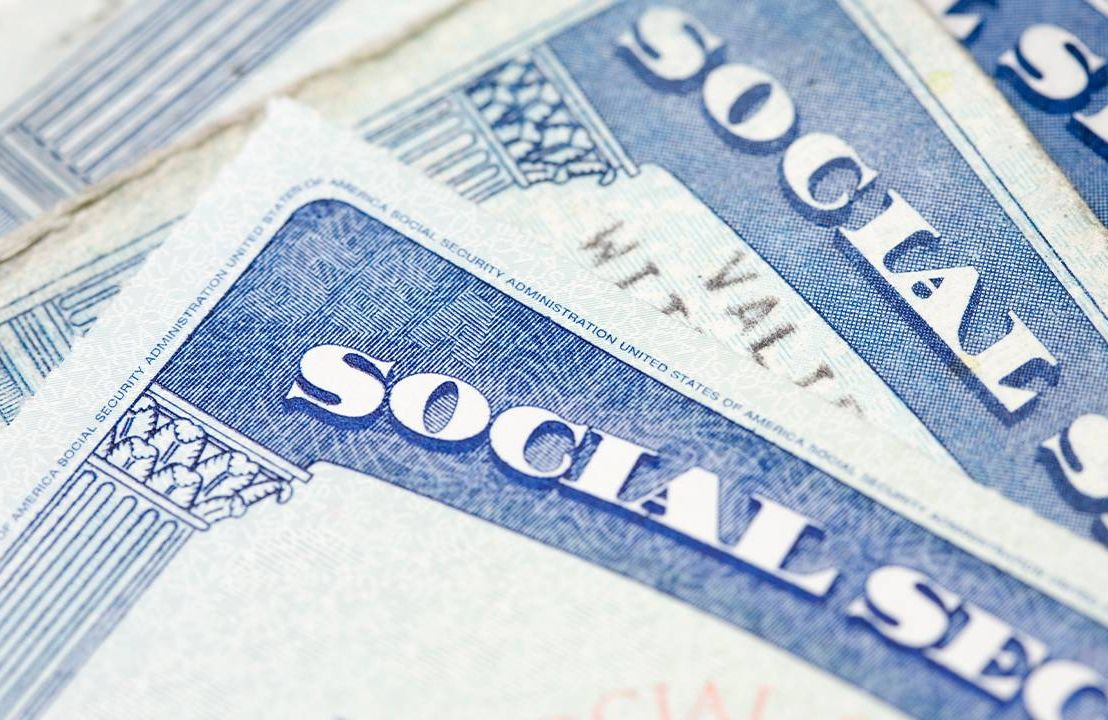 A closeup of three social security cards. Next Avenue, solvency