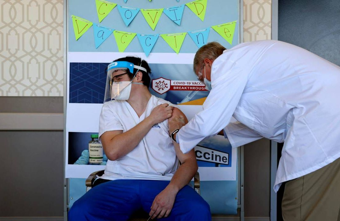 A nursing home staff member getting a COVID-19 vaccine shot. Next Avenue, Long-term care staff shortages, vaccine mandates