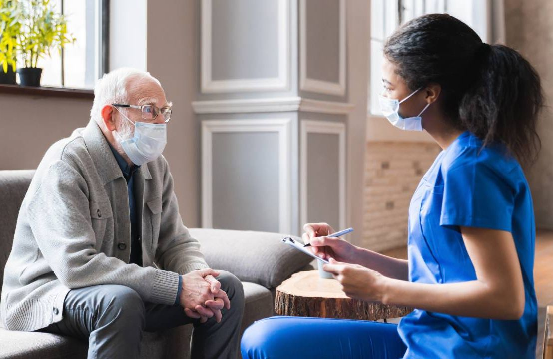 A doctor and a patient talking. Next Avenue