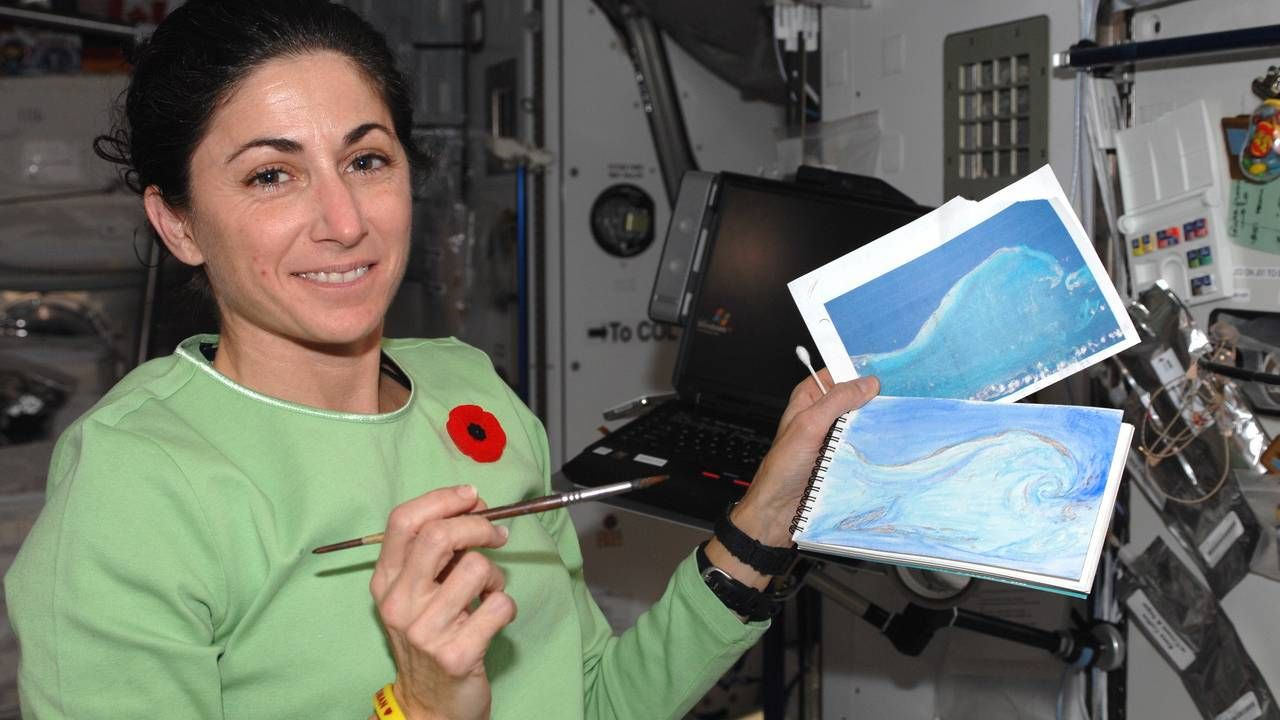 Astronaut Nicole Stott painting a watercolor image. Next Avenue, space