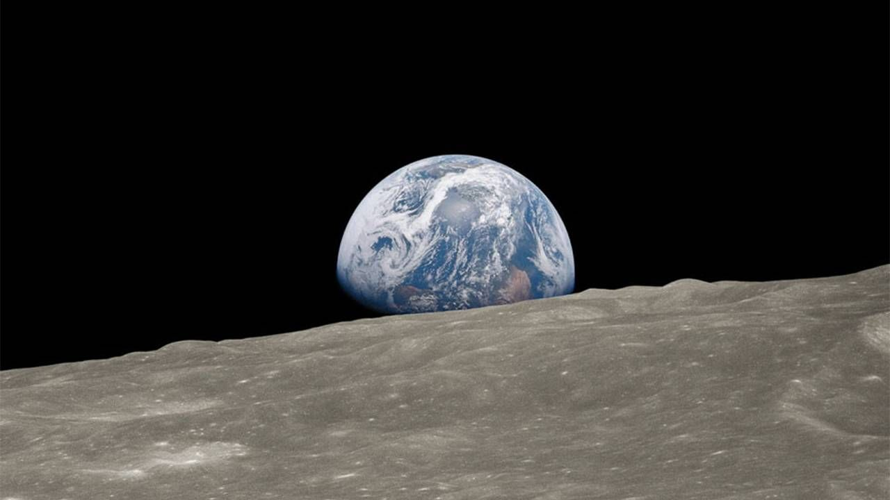 The earth rising over the moon from outer space. Next Avenue, Astronaut Nicole Stott, space