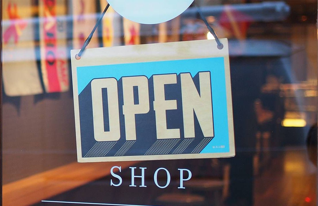 An open sign on the door of a small business. Next Avenue, money to start business, financing small business