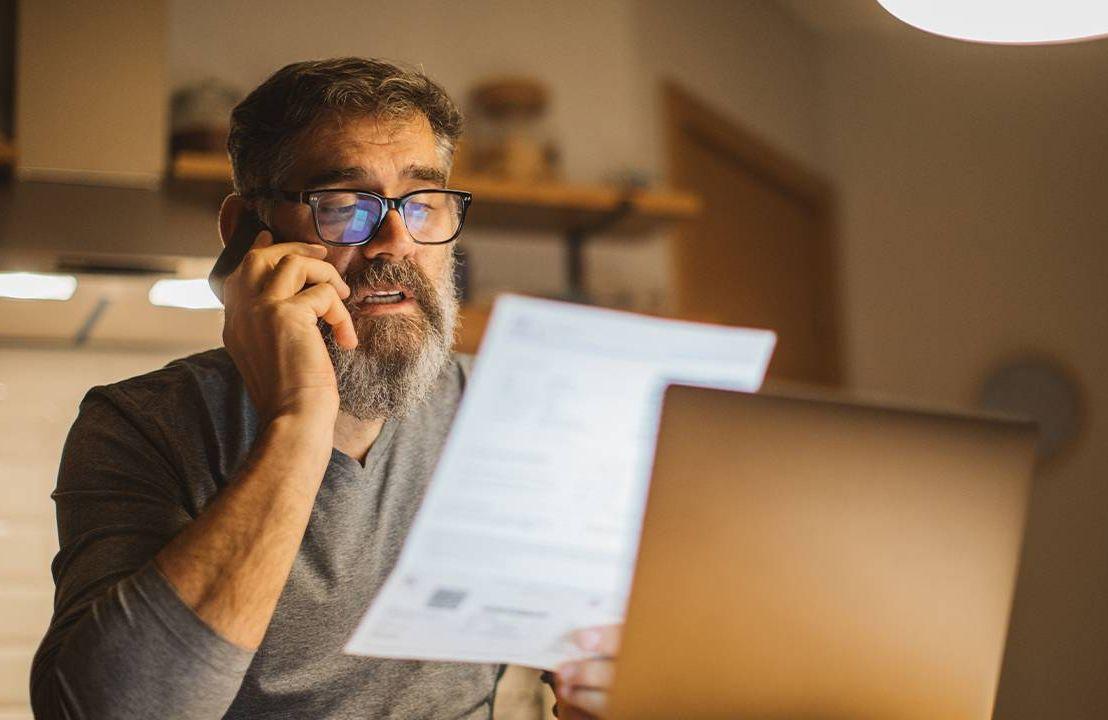 A man paying for a medical bill. Next Avenue, health insurance claim, medical bill, denied claim