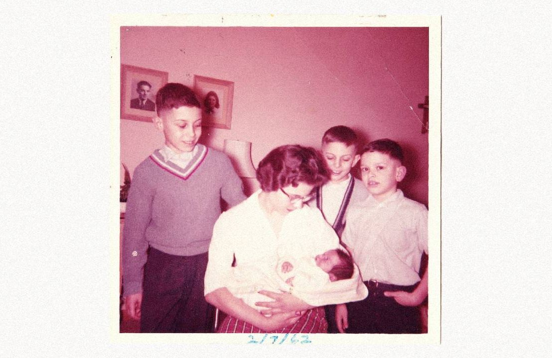 An old photo of a family holdng a newborn. Next Avenue, siblings, sibling relationships, forgiving family