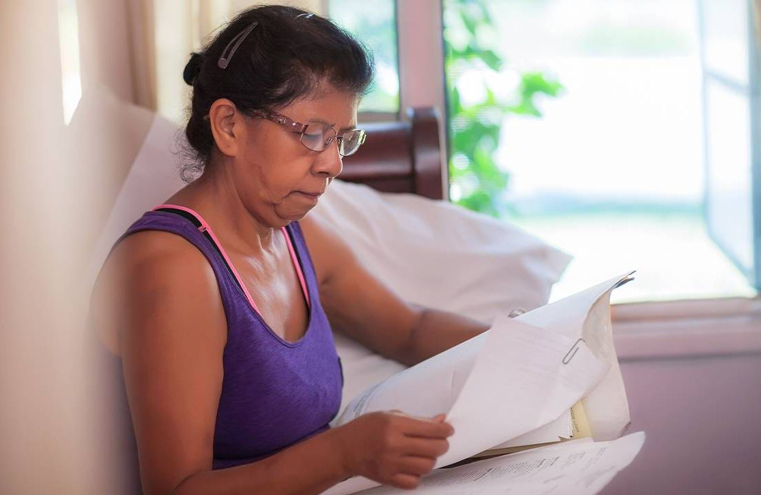 A woman looking at bills, planning retirement. Next Avenue, future of retirement, pandemic, COVID-19