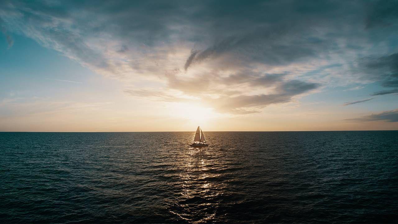 A sailboat on the horizon. Next Avenue, covid-19, dreams into reality, goals