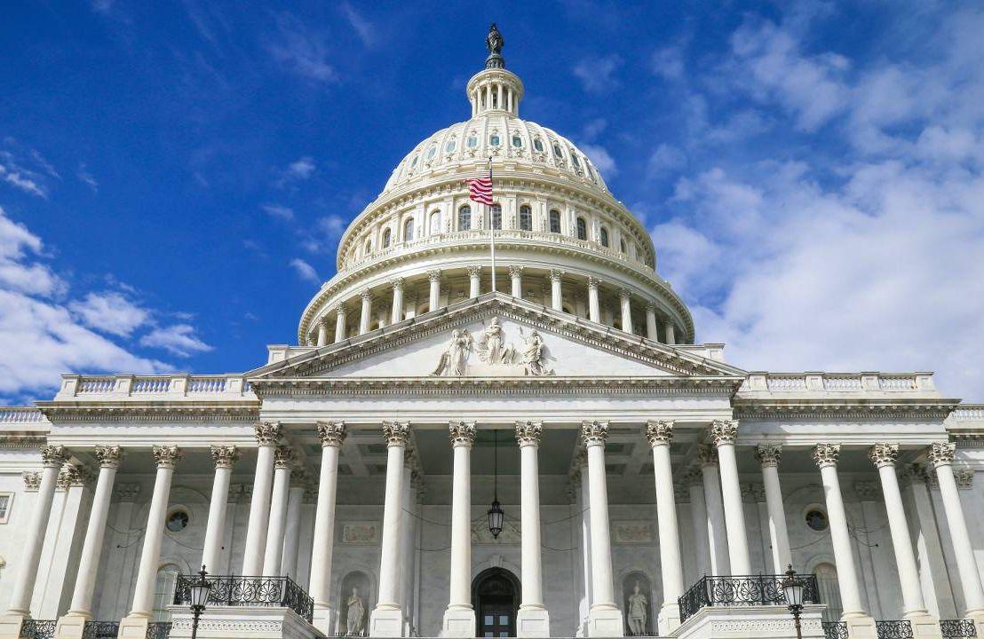 The U.S. Capitol building against a blue sky. Next Avenue, Build Back Better Act, BBB