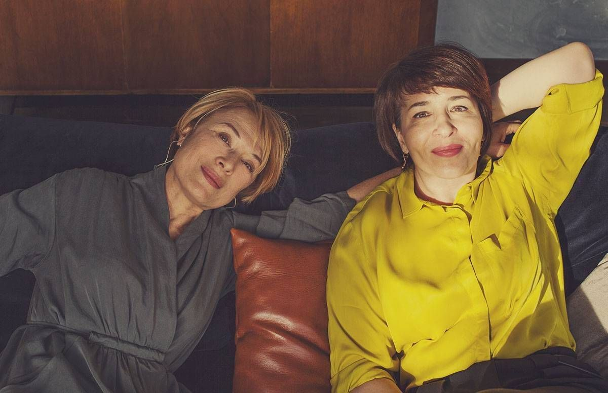 Two sisters on a couch. Next Avenue, sibling estrangement