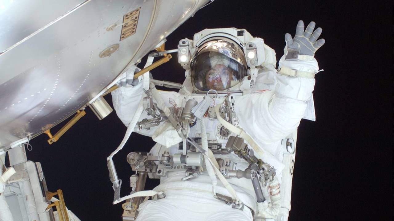 Astronaut Nicole Stott doing a space walk in outer space. Next Avenue, space