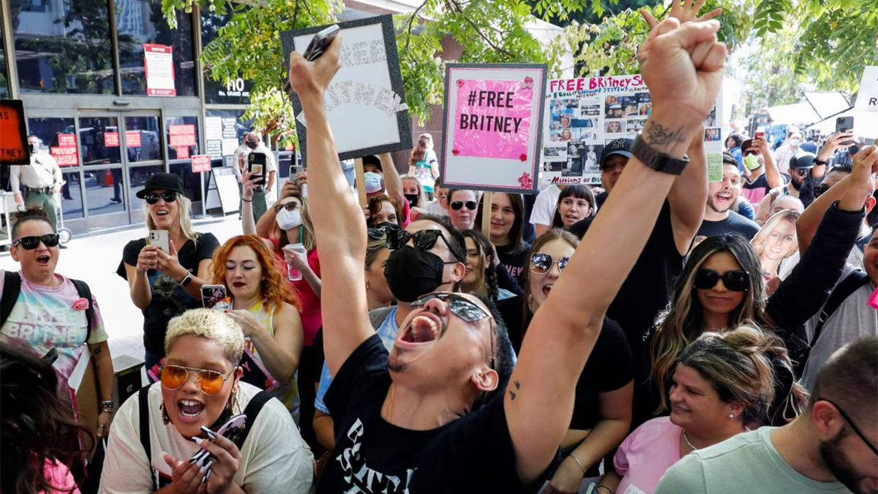 """A group of """"Free Britney"""" supporters celebrating. Next Avenue, fixing conservatorship laws, corrupt conservators"""
