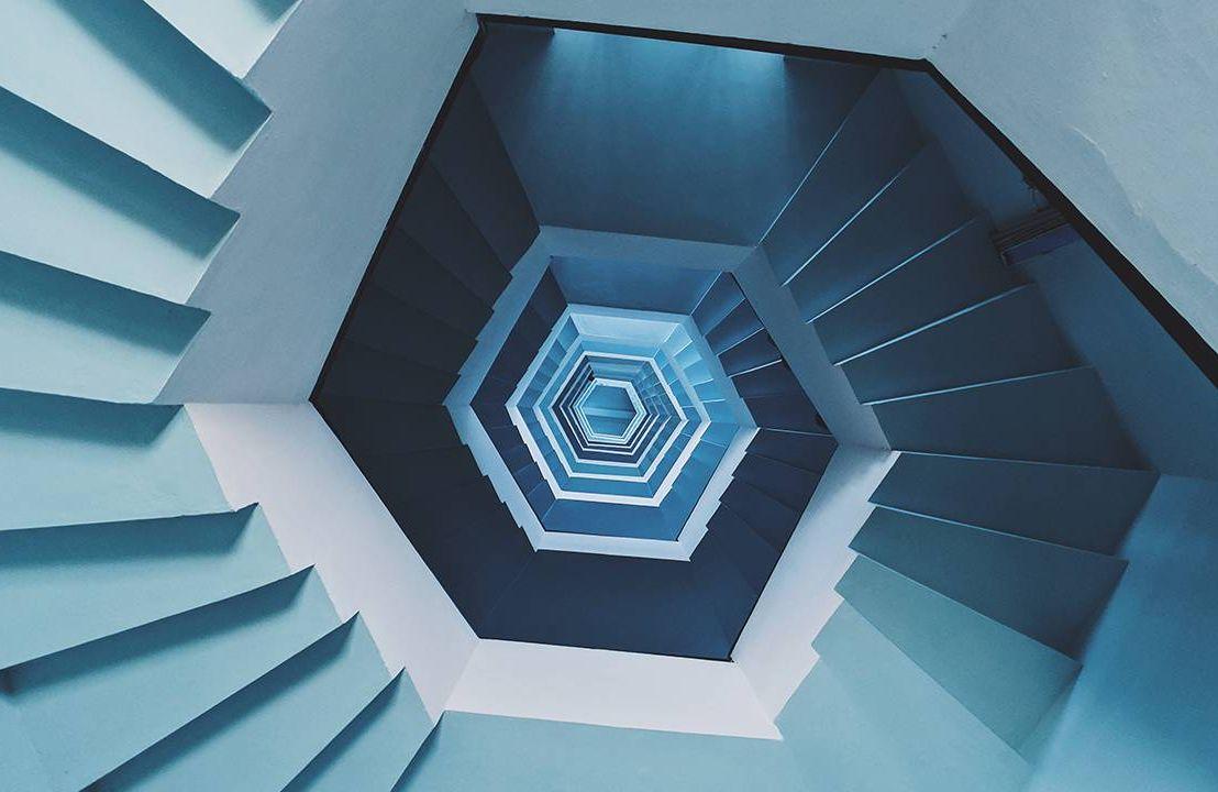 Looking down the center of a spiral staircase. Next Avenue, vertigo signs symptoms, Meniere's disease