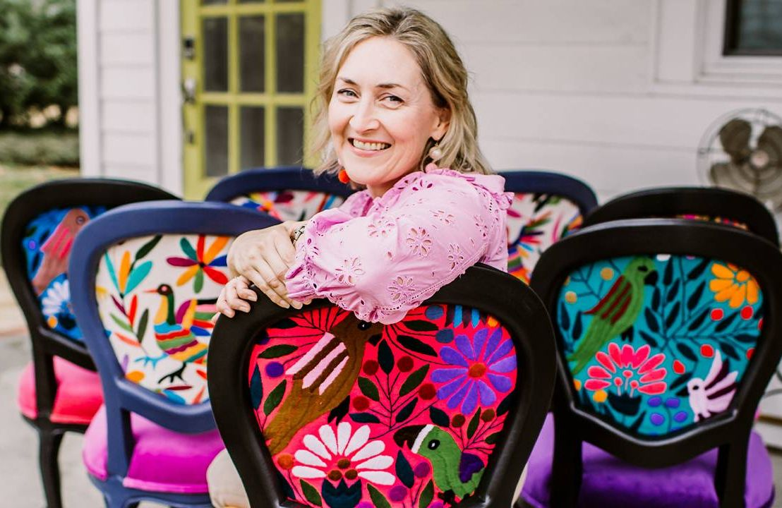 A woman sitting in a colorful chair. Next Avenue, side hustle business