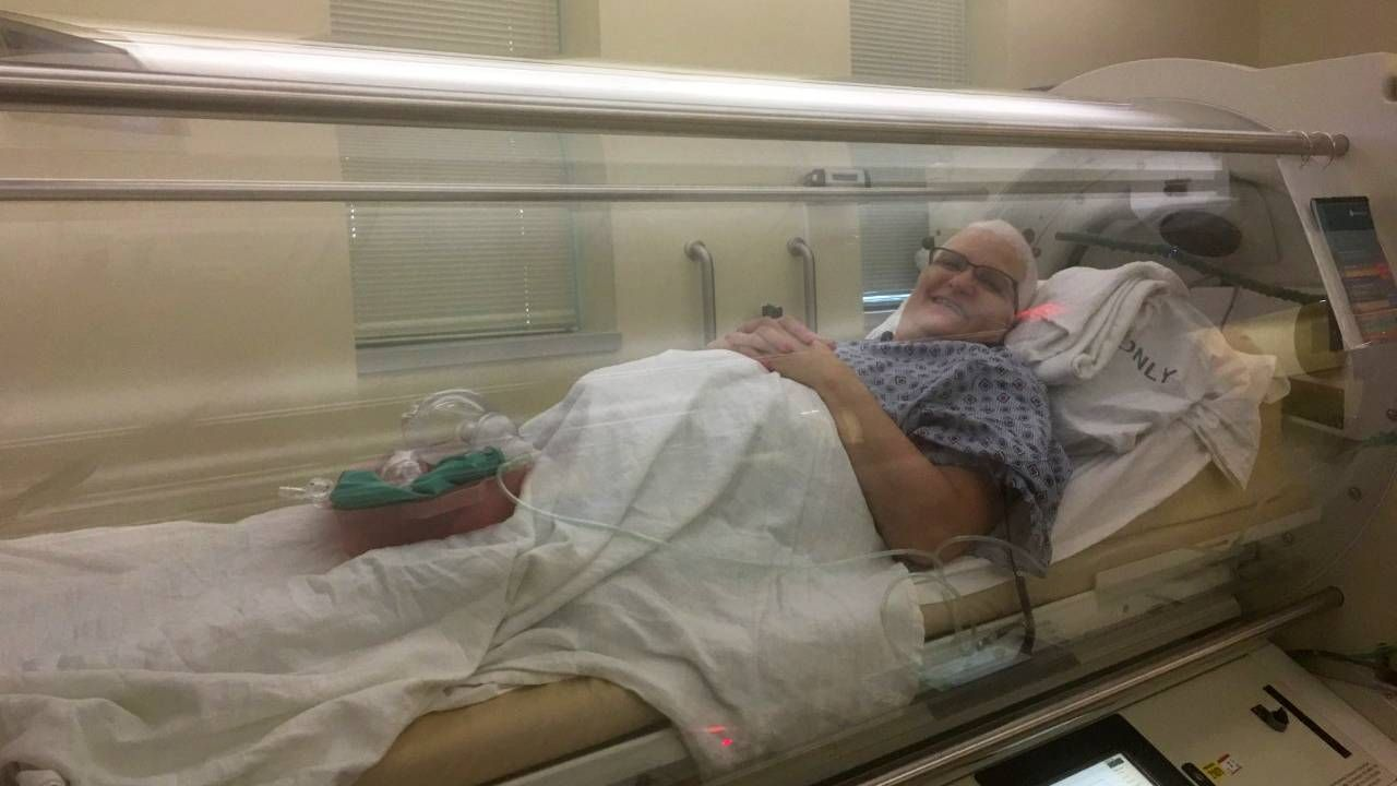 A person in a hyperbaric chamber. Next Avenue, wound won't heal, chronic wound