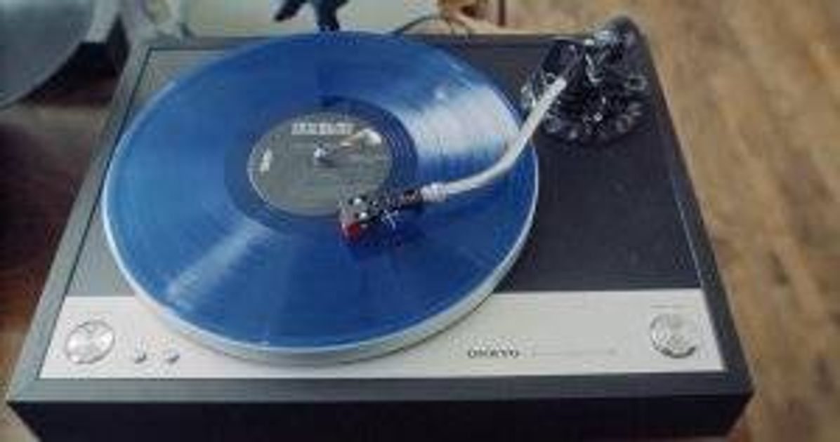 A clear blue record on a player Vinyl Collection pbs rewire