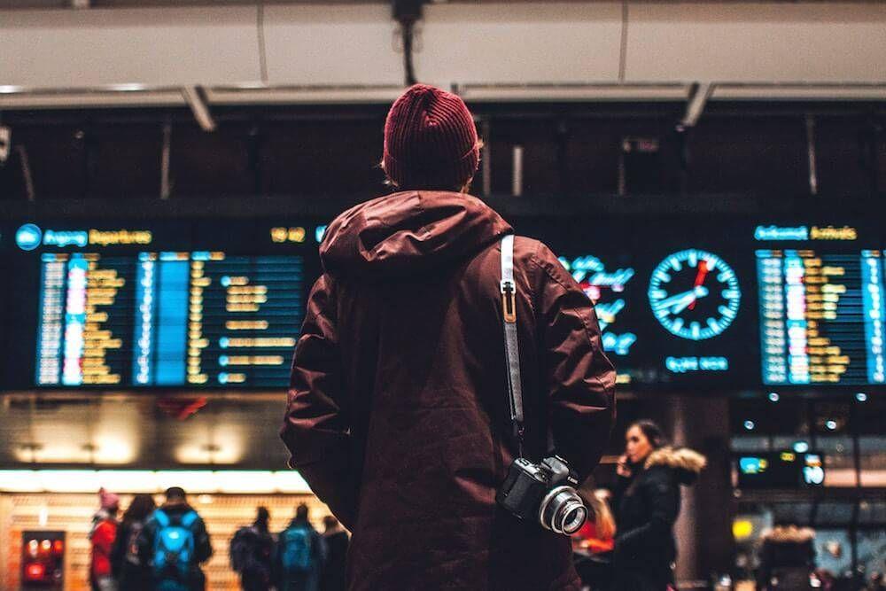A person in a beanie in an airport. Fear pbs rewire