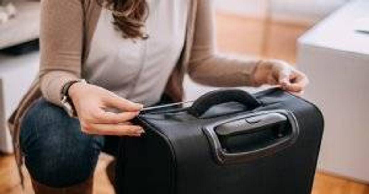 Woman measuring luggage. Budget Airline pbs rewire
