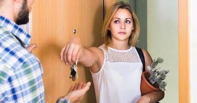 Woman giving her ex-boyfriend the keys to their apartment as she leaves. Living Together pbs rewire