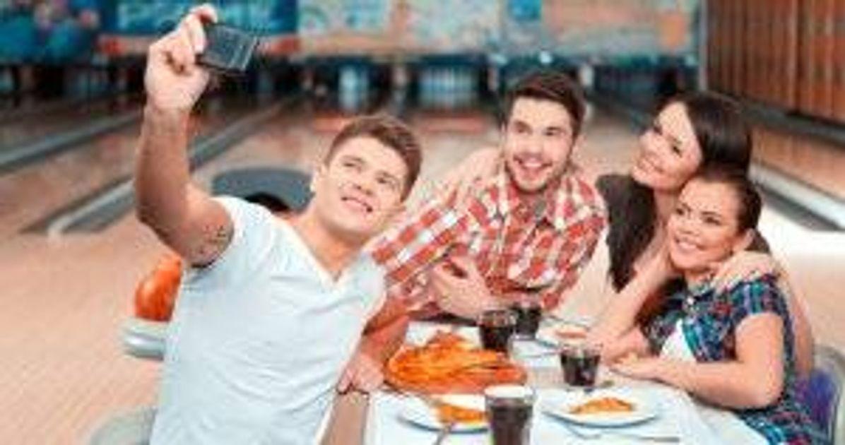 Friends taking a selfie in a bowling alley. Big Breakup pbs rewire