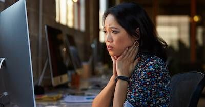 Young asian woman is unhappy while looking at her computer screen. Quit Your Job pbs rewire