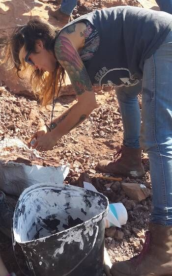 Photo of Jingmai O'Connor working on a paleontology dig. pbs rewire