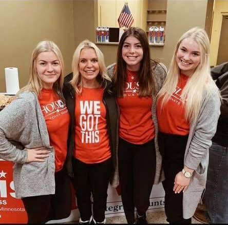 A group of volunteers for Karin Housley's political campaign stand with Karin Housley. REWIRE PBS Our Future Campaign Volunteer