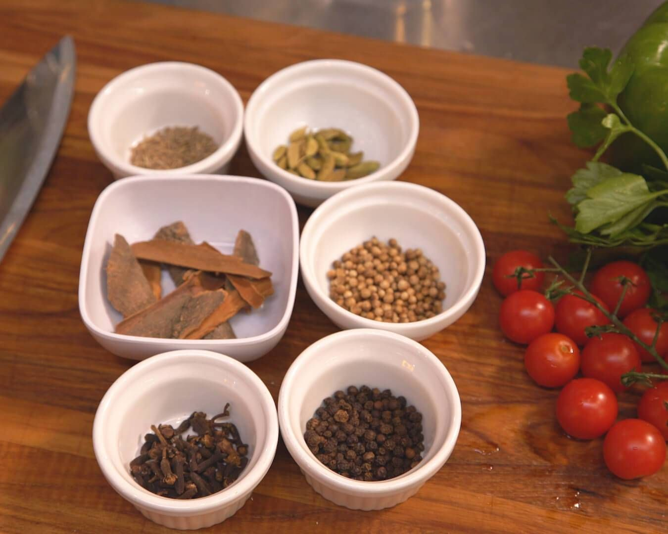 A photo of small ramekins with individual, whole spices in each. Rewire PBS Living Jamal Hashi