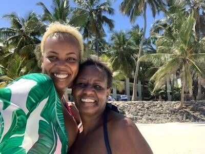 Photo of author Kui Mwai and her mother, on a beach in Nairobi. Rewire PBS Love Parents
