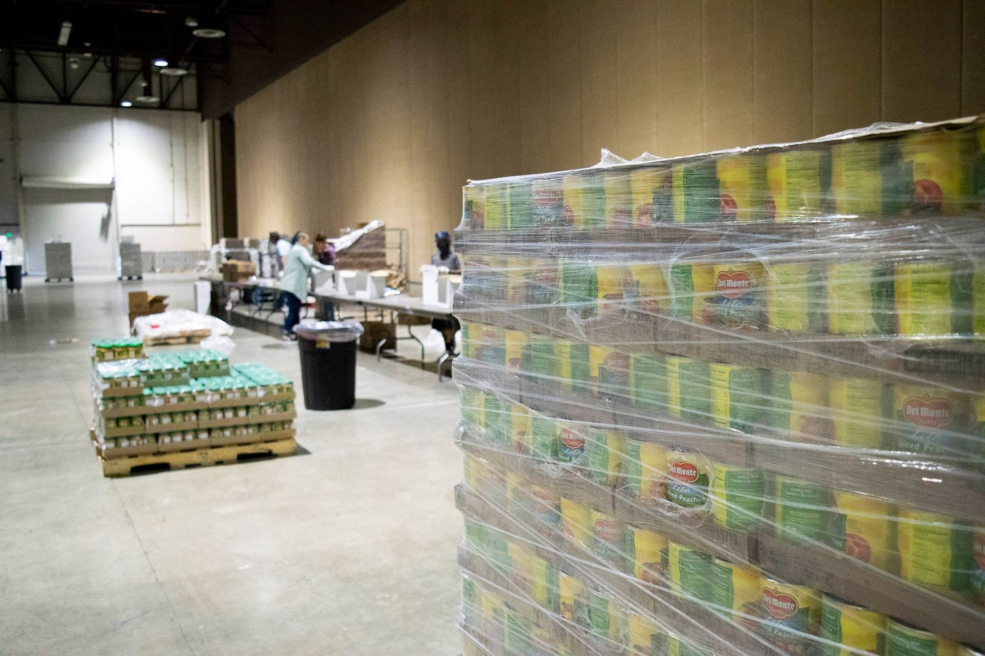 Photo of a pallet of canned food inside a warehouse. Rewire PBS Our Future