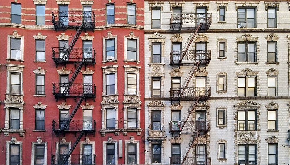 apartment buildings in a city. REWIRE PBS our future rights as a renter