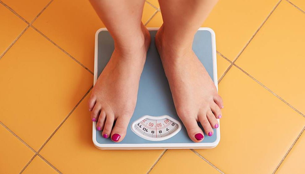 Feet on a scale weight loss. REWIRE PBS Health COVID 15