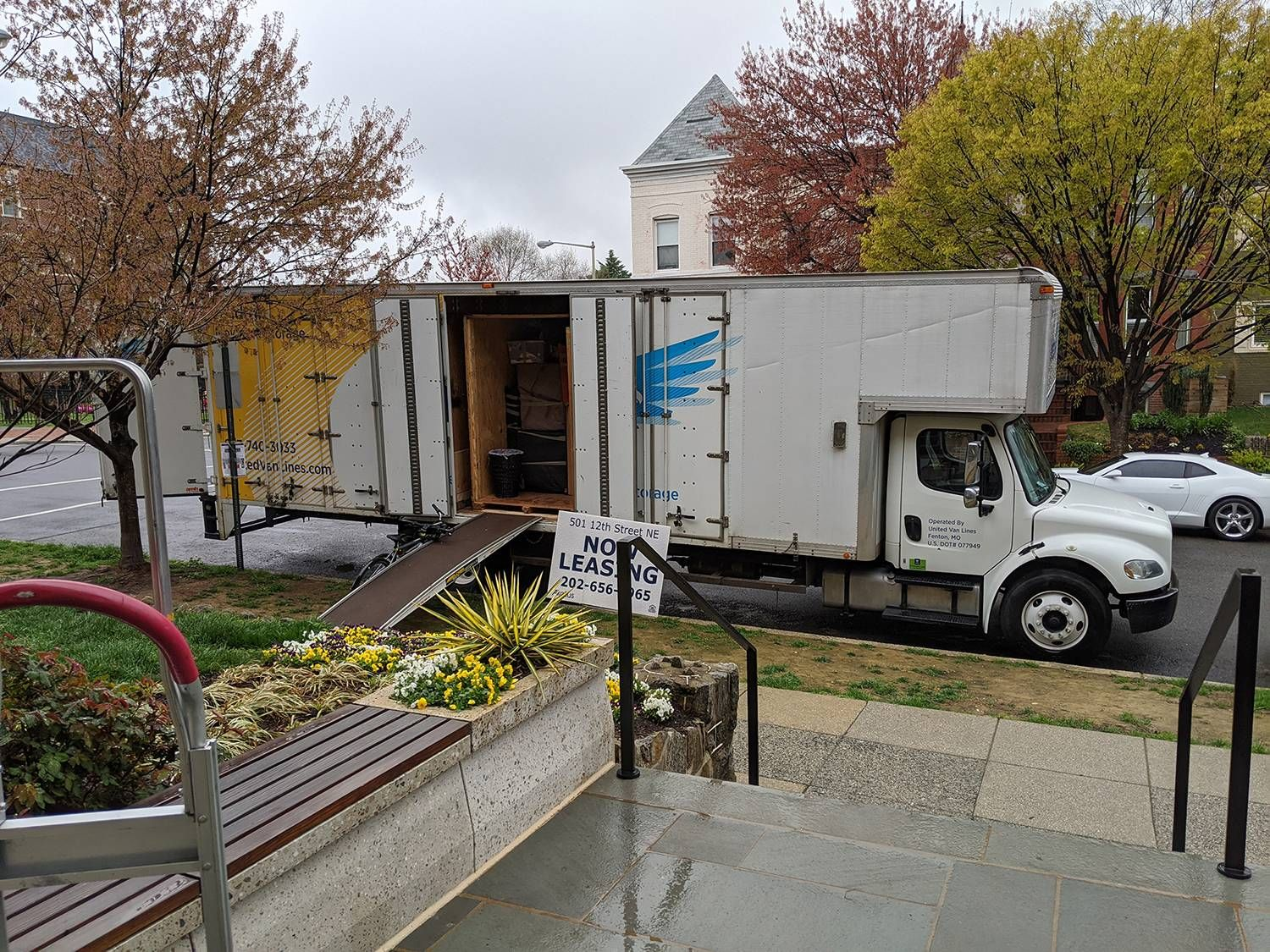 Photograph of a moving van parked at a curb. Rewire PBS Living Moved