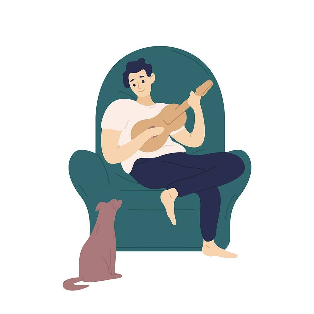 Man playing guitar for his dog. REWIRE PBS health living analog hobbies