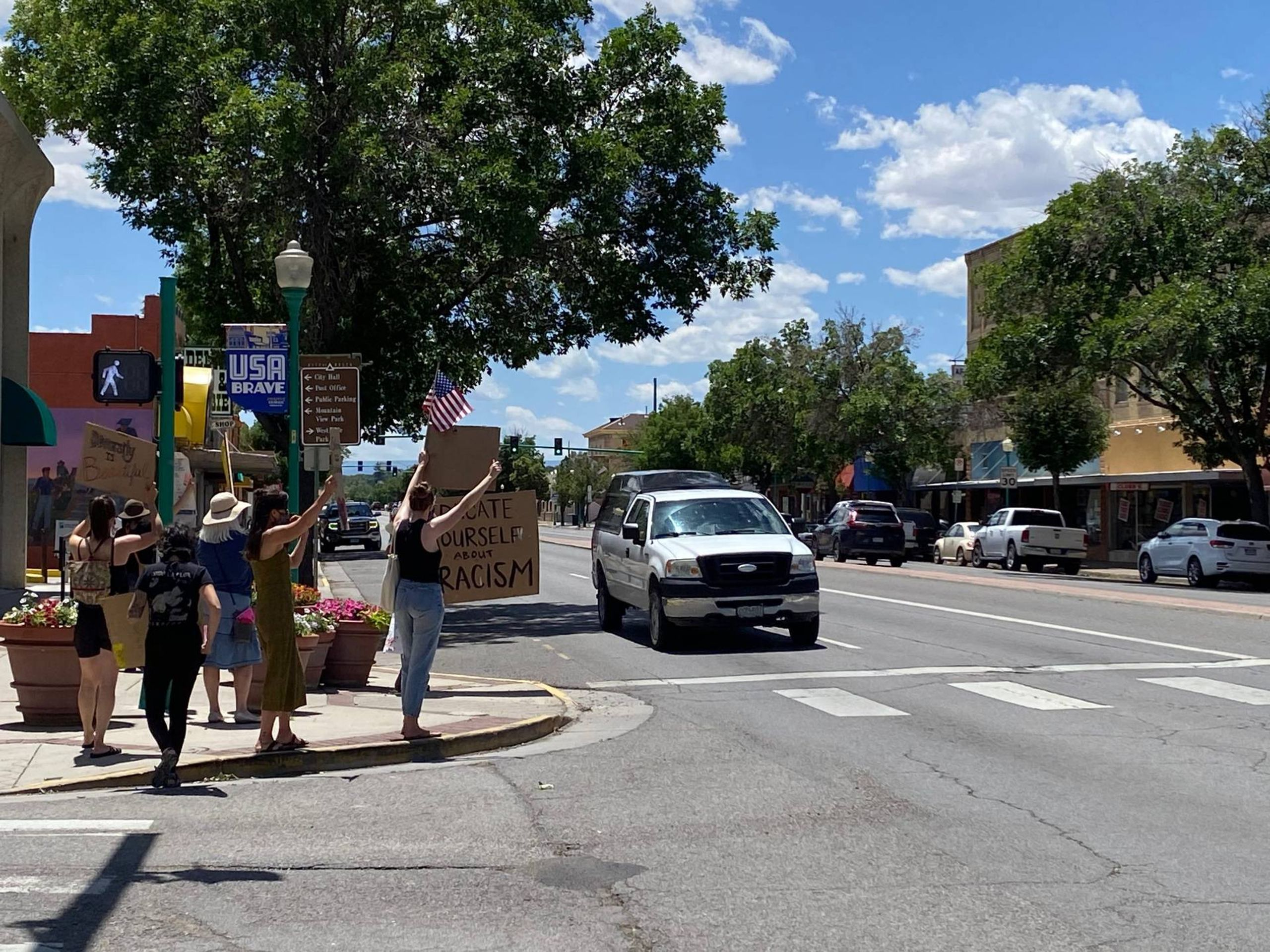 Protesters demonstrate on a corner in the Western Slope of Colorado. Rewire PBS Our Future Rural Activism