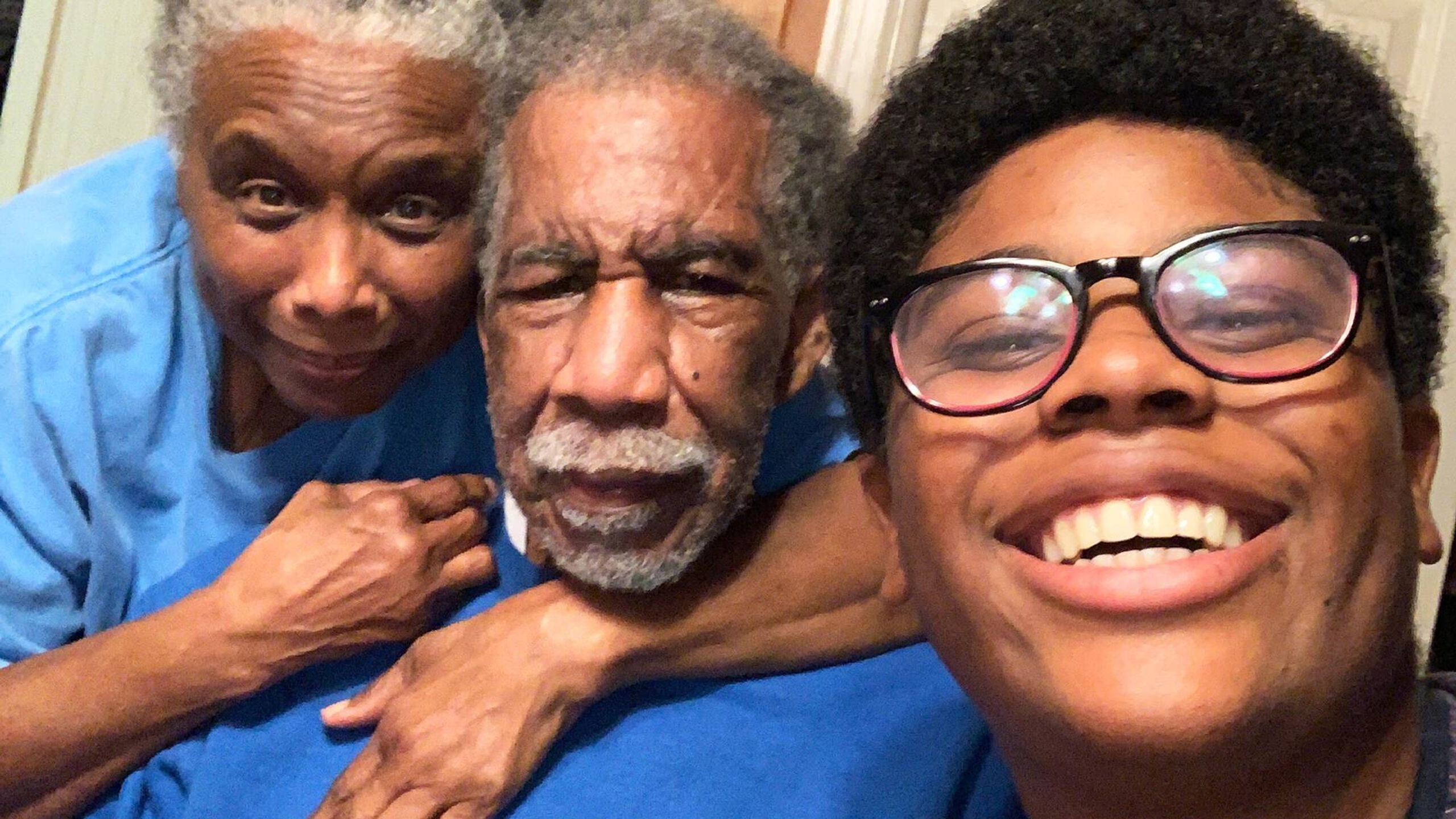 An intergenerational selfie of Lumiere Rostick and his grandparents. Rewire PBS Love Caregiver Lumiere Rostick