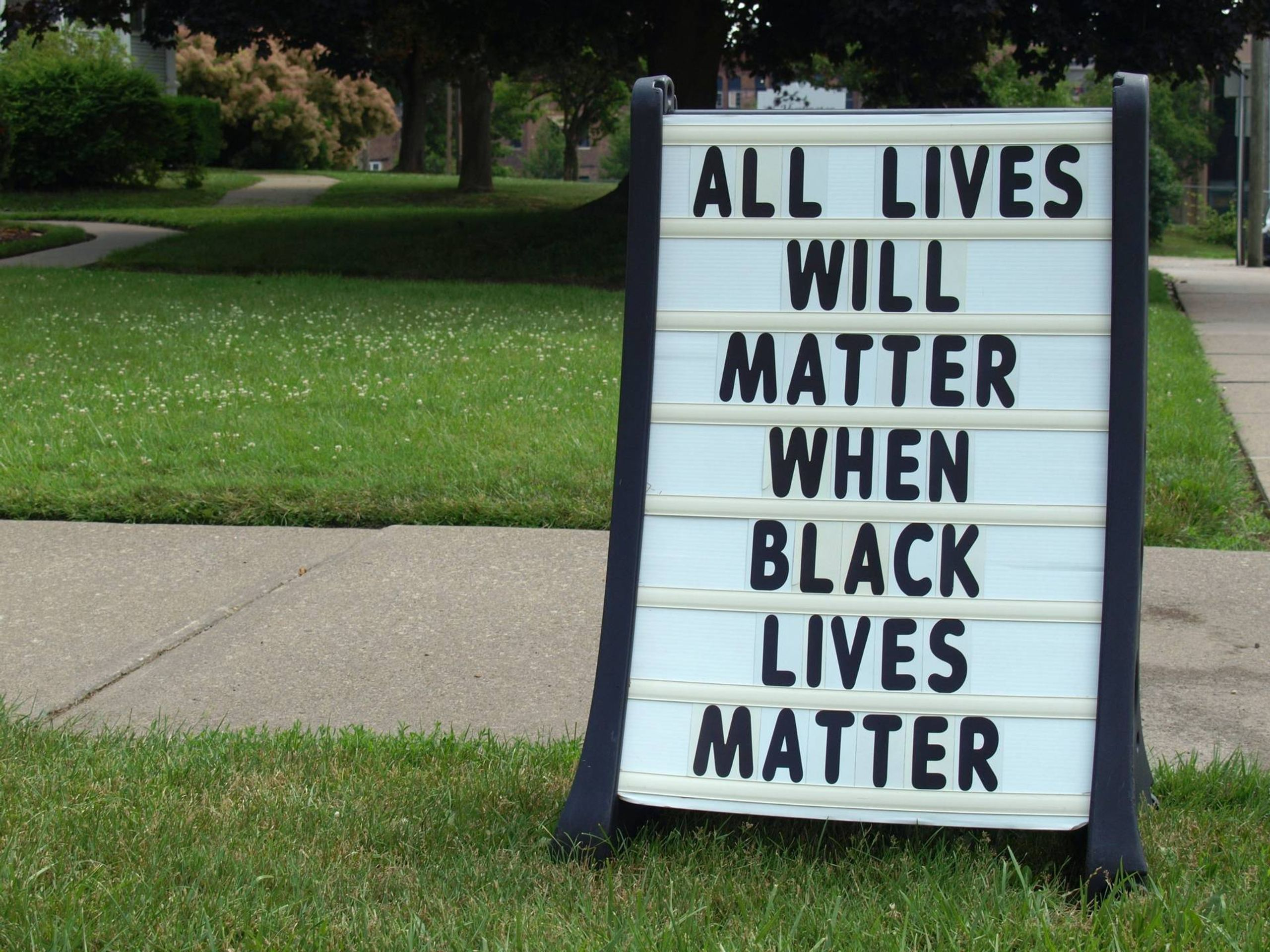 Sign outside a church in support of Black Lives Matter. Rewire PBS Love Toxic Posivity