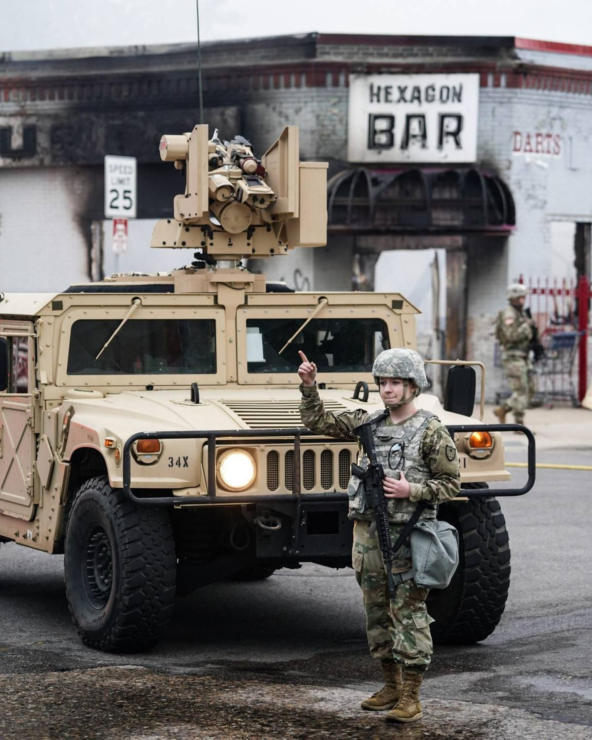 Members of the Minnesota National Guard direct traffic away from an active structure fire in Minneapolis on May 29, 2020. REWIRE PBS Our Future Black Lives