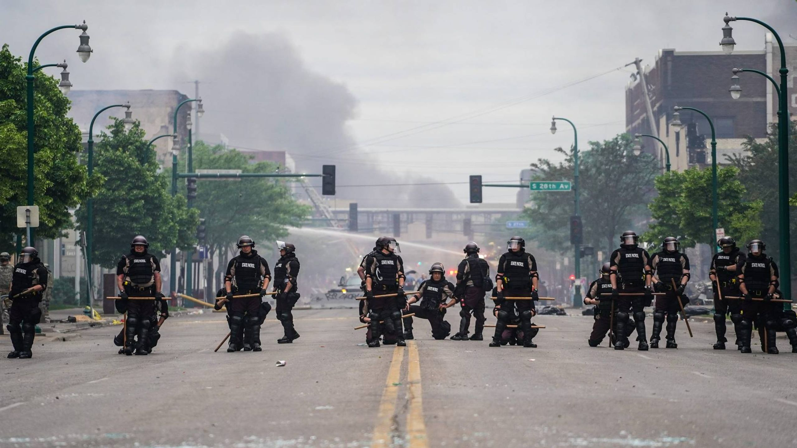 Riot police form a line on a Minneapolis street