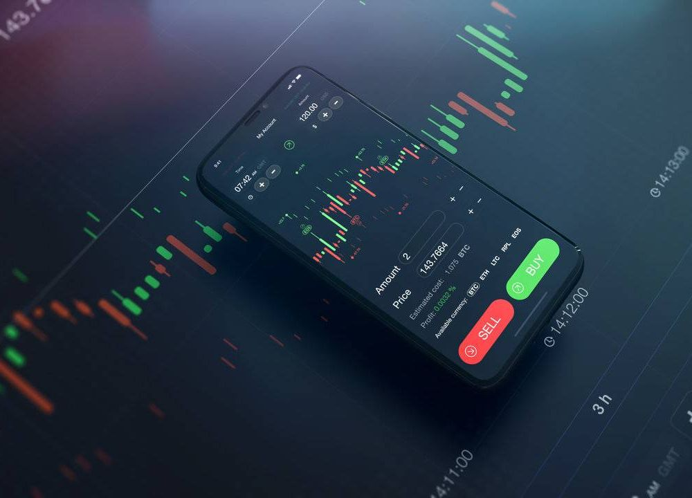 Mobile trading app on smartphone with financial data background. Rewire PBS Money Stocks