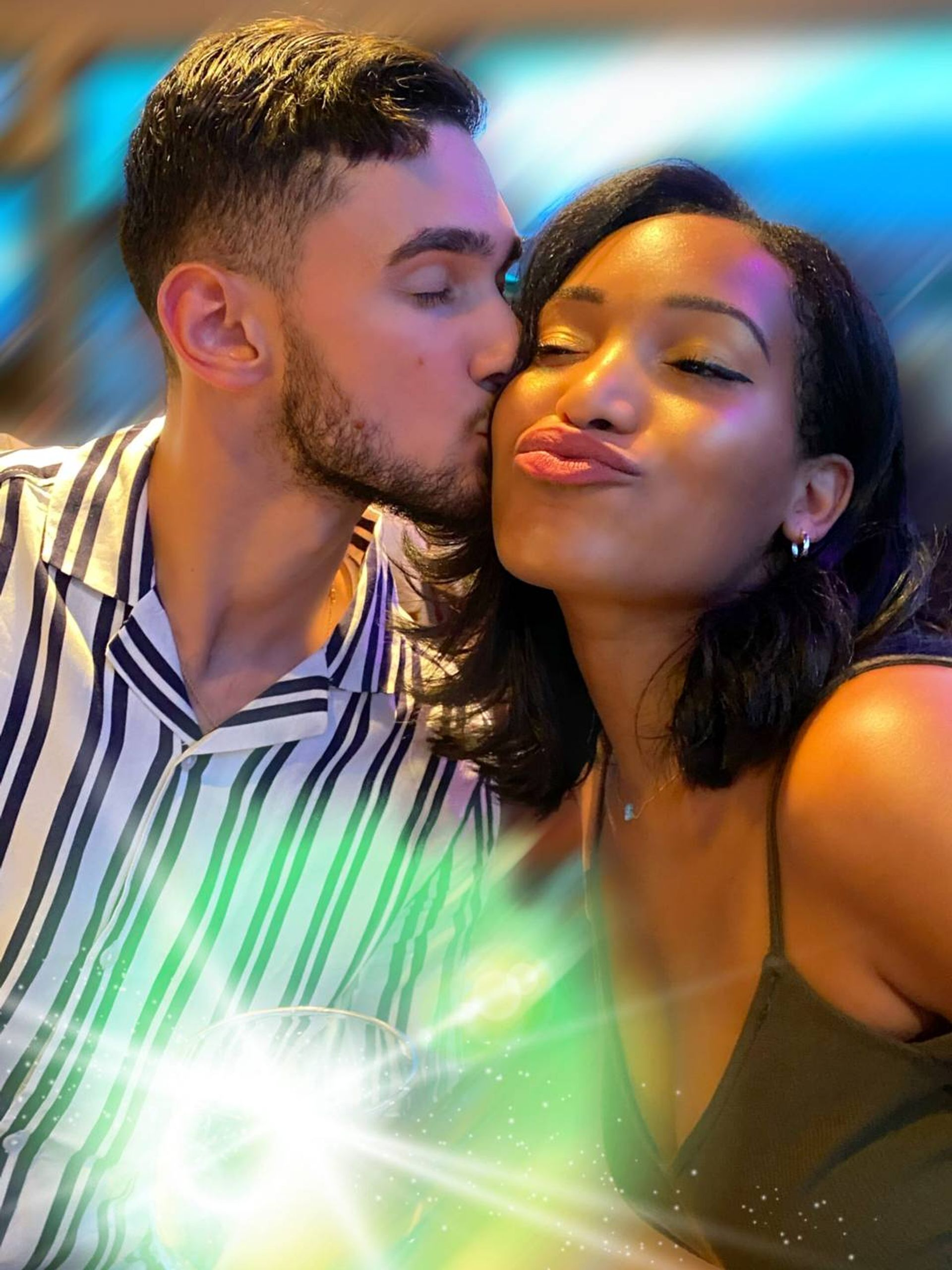 Portrait of a young interracial couple kissing. REWIRE PBS Our Future Love interracial couple