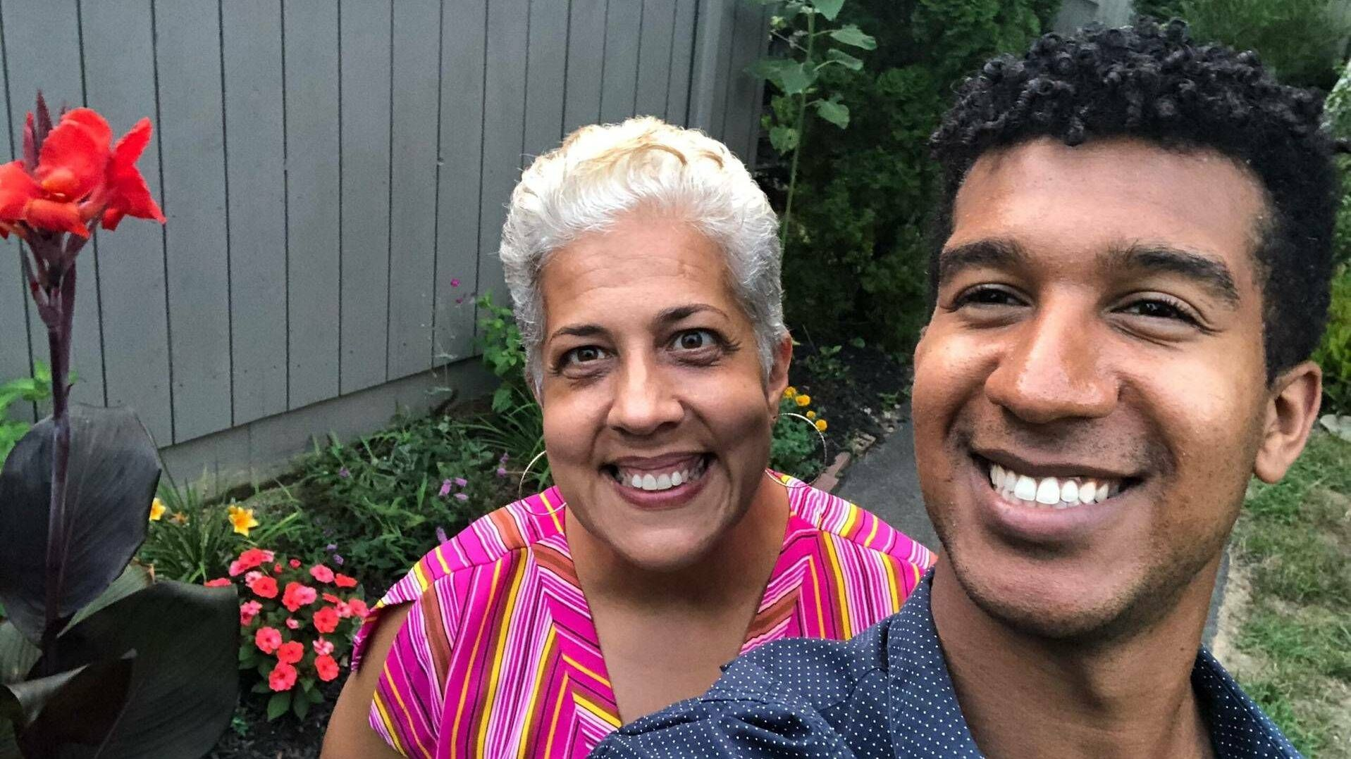 A son and his mom take a selfie outside in their garden in summer. Rewire PBS Love Gardener