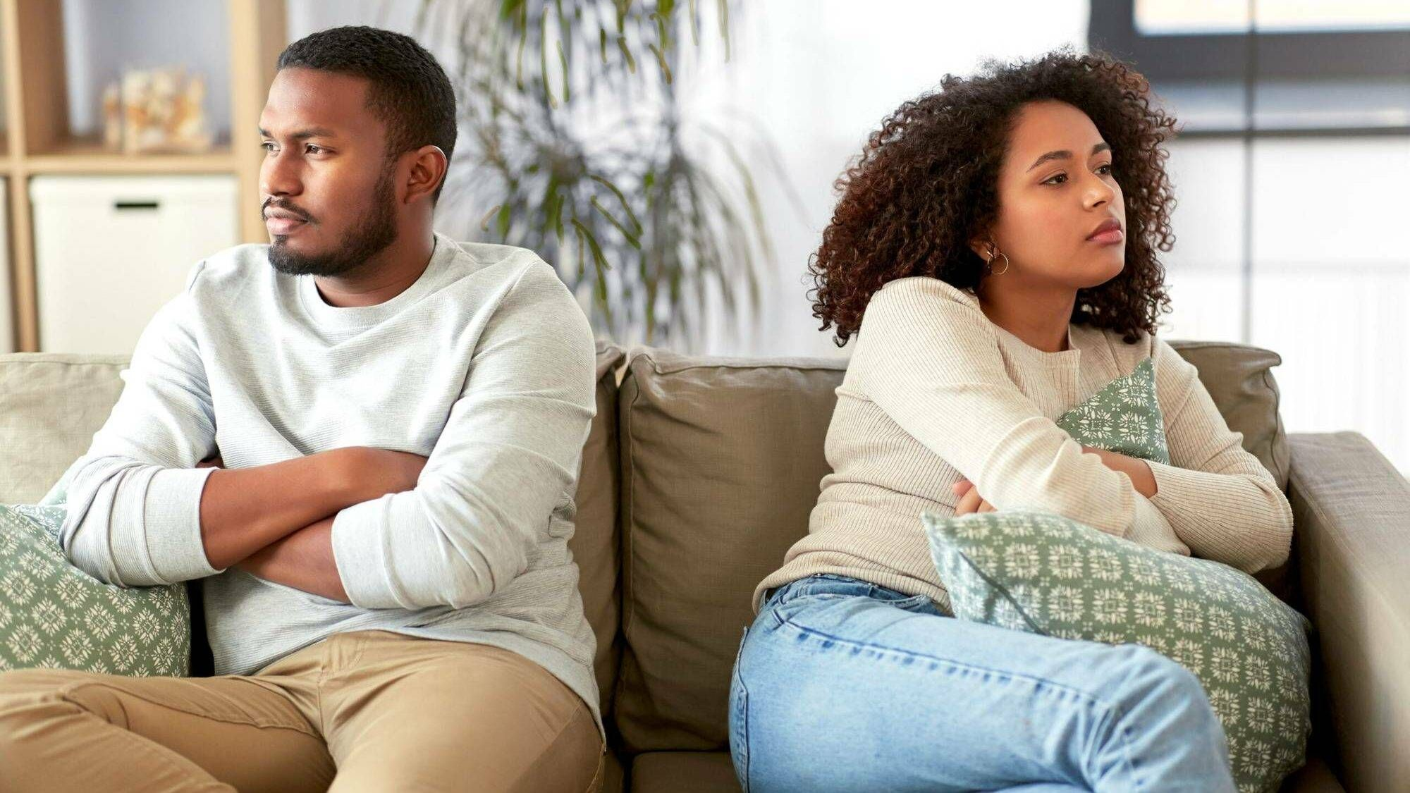 unhappy couple sitting on couch and having argument at home. Rewire PBS Love Couples therapy