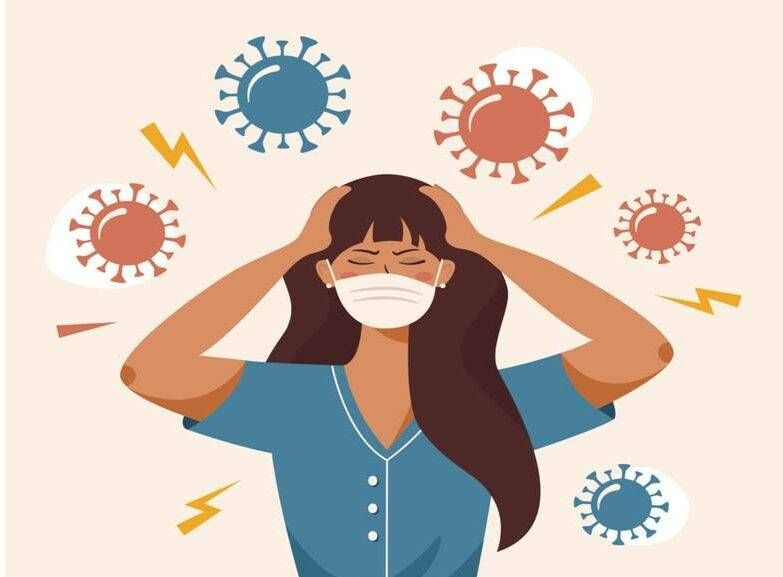 Illustration of a woman who clutches at head with both hands, surrounded by coronavirus. Rewire, COVID anxiety
