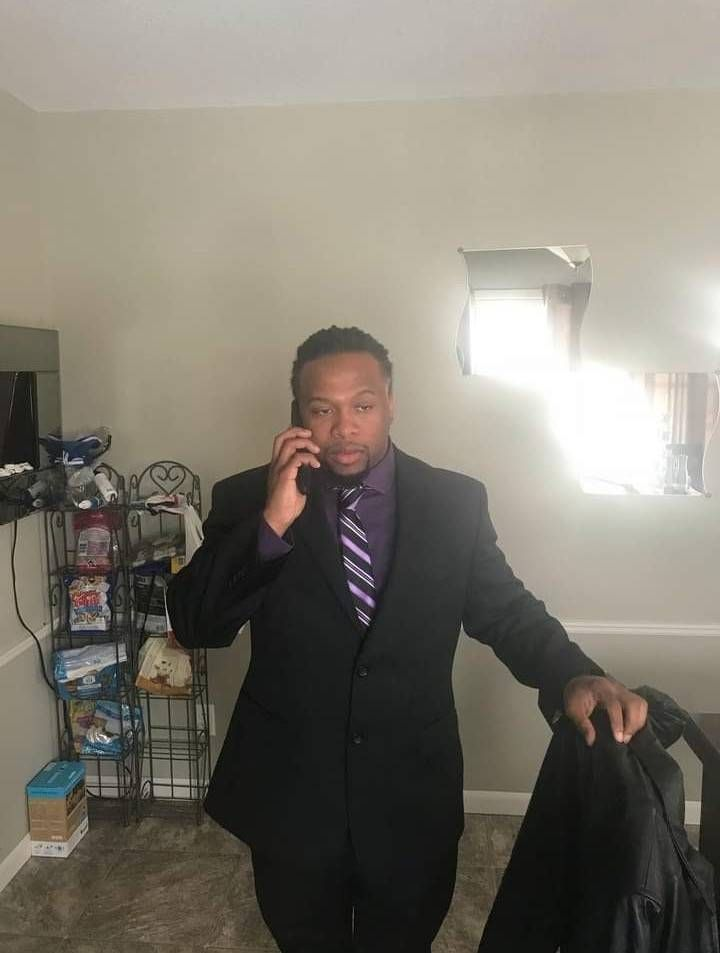 Photo of a Black man in a suit, talking on the phone. Rewire PBS Our Future Can't Vote.