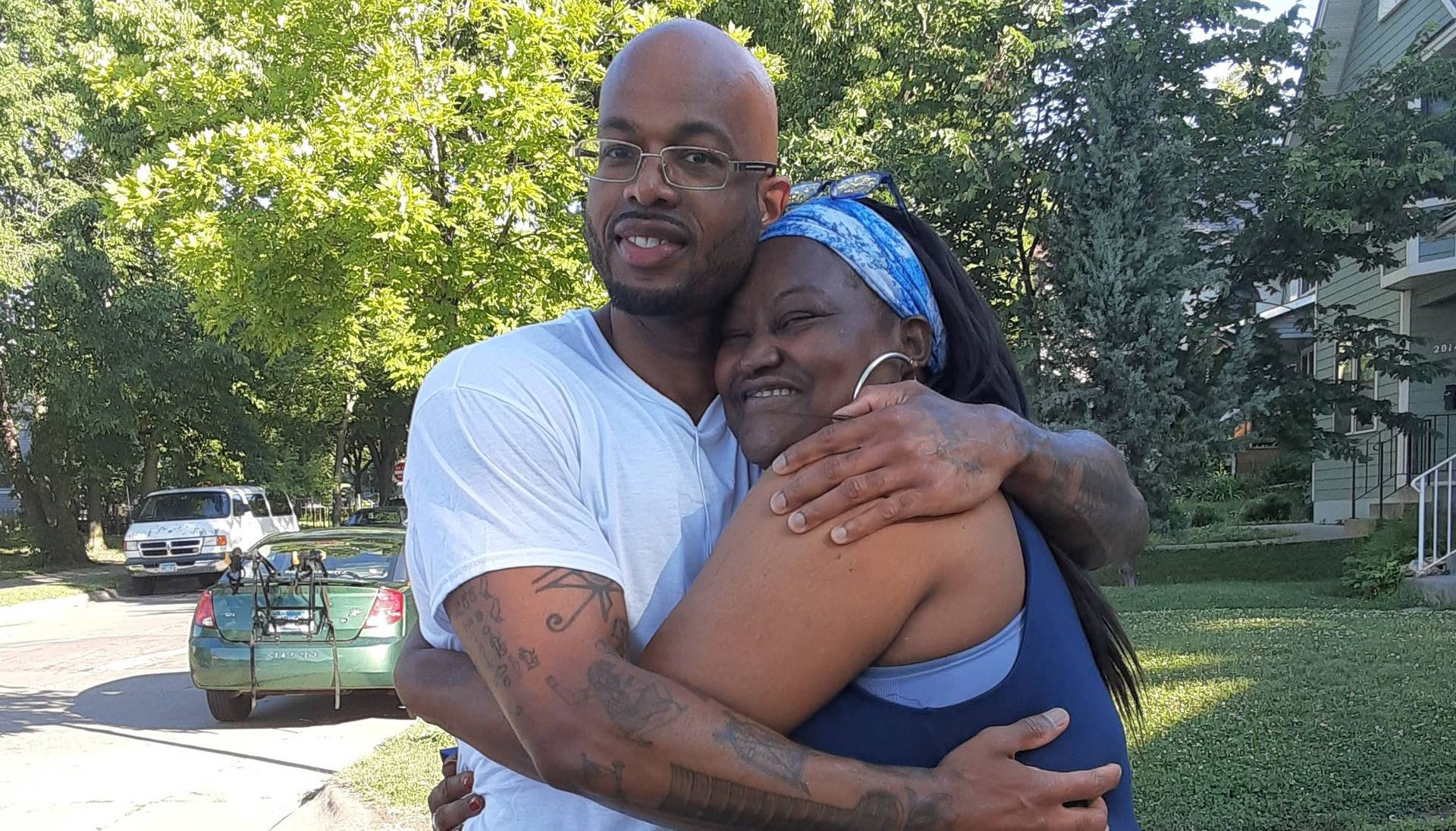 Photo of a Black man, Antonio Williams, hugging his mother. Rewire PBS Our Future Can't Vote