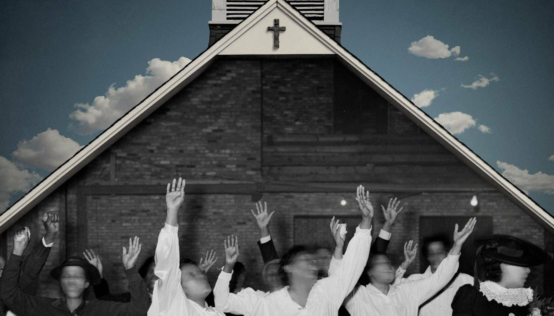 Photo of people with hands in the air and faces blurred by motion, standing in front of a church